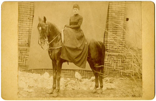 Belle Hawkes on a horse, Iran, 1883.